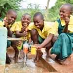 The Water Project: Nzalae Primary School -  Water Flowing