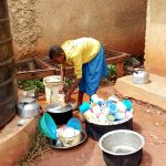 The Water Project: Kegoye Primary School -  Helping Clean Utensils At Plastic Tank