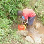 The Water Project: Eshiakhulo Community, Kweyu Spring -  Fetching Water