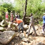 The Water Project: Mbau Community C -  Community Members Gathering Stones For More Water Points