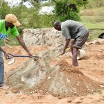 The Water Project: Mitini Community B -  Mixing Cement