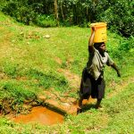 The Water Project: Wajumba Community, Wajumba Spring -  Carrying Water