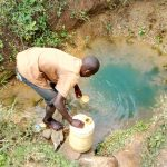 The Water Project: Mukhuyu Community, Kwakhalakayi Spring -  Fetching Water