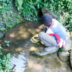 The Water Project: Munenga Community, Burudi Spring -  Fetching Water