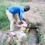 The Water Project: Emukoyani Community, Ombalasi Spring -  Fetching Water