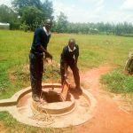The Water Project: Namasanda Secondary School -  Fetching Water From The Open Well