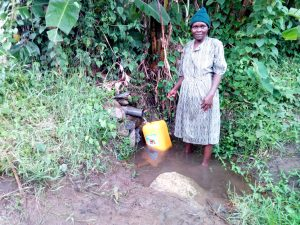 The Water Project:  Mrs Ngovilo Fetching Water
