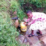 The Water Project: Bukhaywa Community, Asumani Spring -  Fetching Water