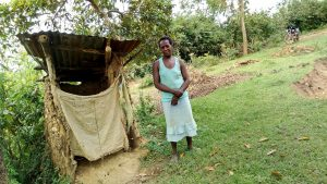 The Water Project:  A Community Members By Her Mud Latrine