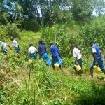 The Water Project: Lwakhupa Primary School -  Carrying Water Back To School