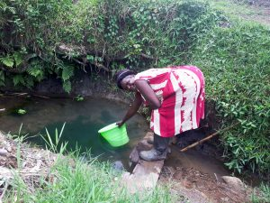 The Water Project:  Miriam Fetching Water