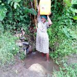 The Water Project: Bukhakunga Community, Ngovilo Spring -  Fetching Water