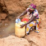 The Water Project: Kathamba Ngii Community A -  Fetching Water