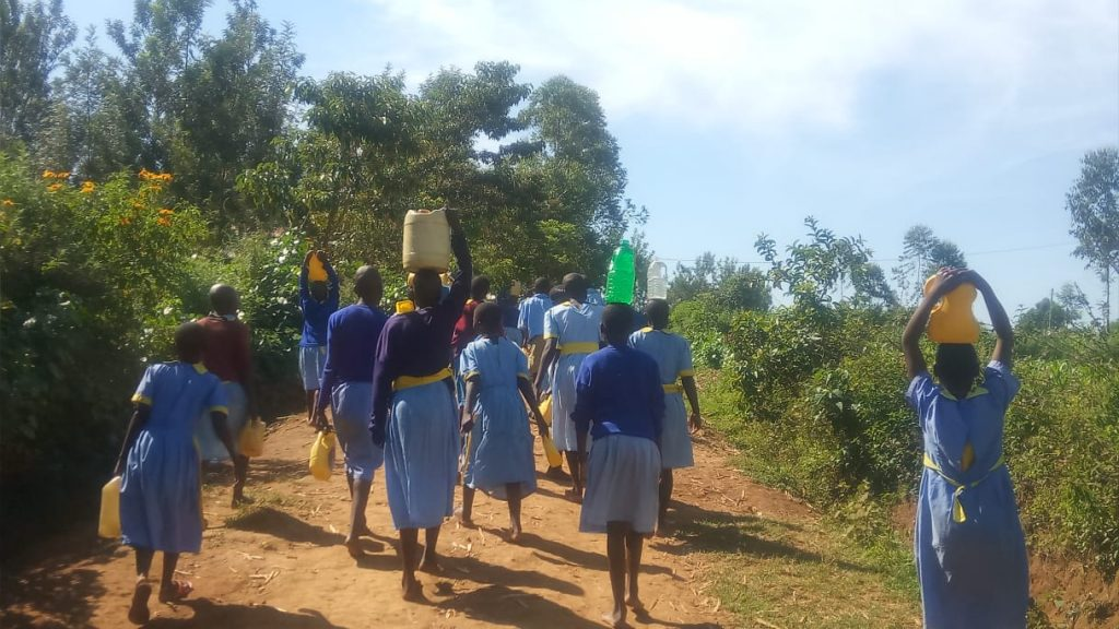 The Water Project : 9-kenya19169-students-carry-water-back-to-school