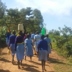 The Water Project: Mabanga Primary School -  Students Carry Water Back To School