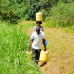 The Water Project: Emukoyani Community, Ombalasi Spring -  Carrying Water