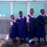 The Water Project: Friends Kaimosi Demonstration Primary School -  Girls Celebrate New Latrines