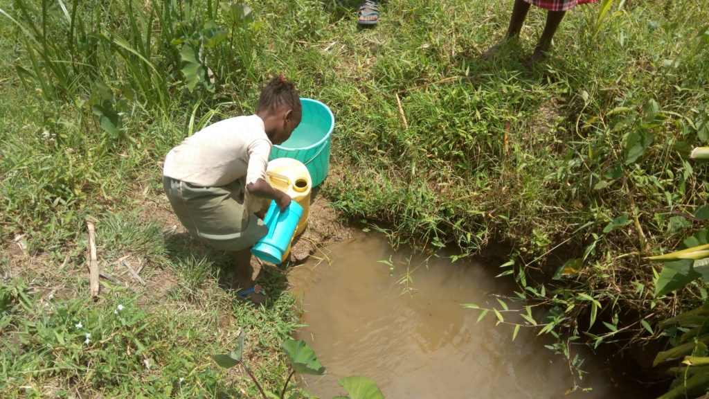 The Water Project : kenya18149-gabriel-fetching-water-at-the-spring