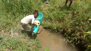 The Water Project:  Gabriel Fetching Water At The Spring