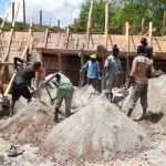 The Water Project: Kyetonye Community -  Shoveling Concrete