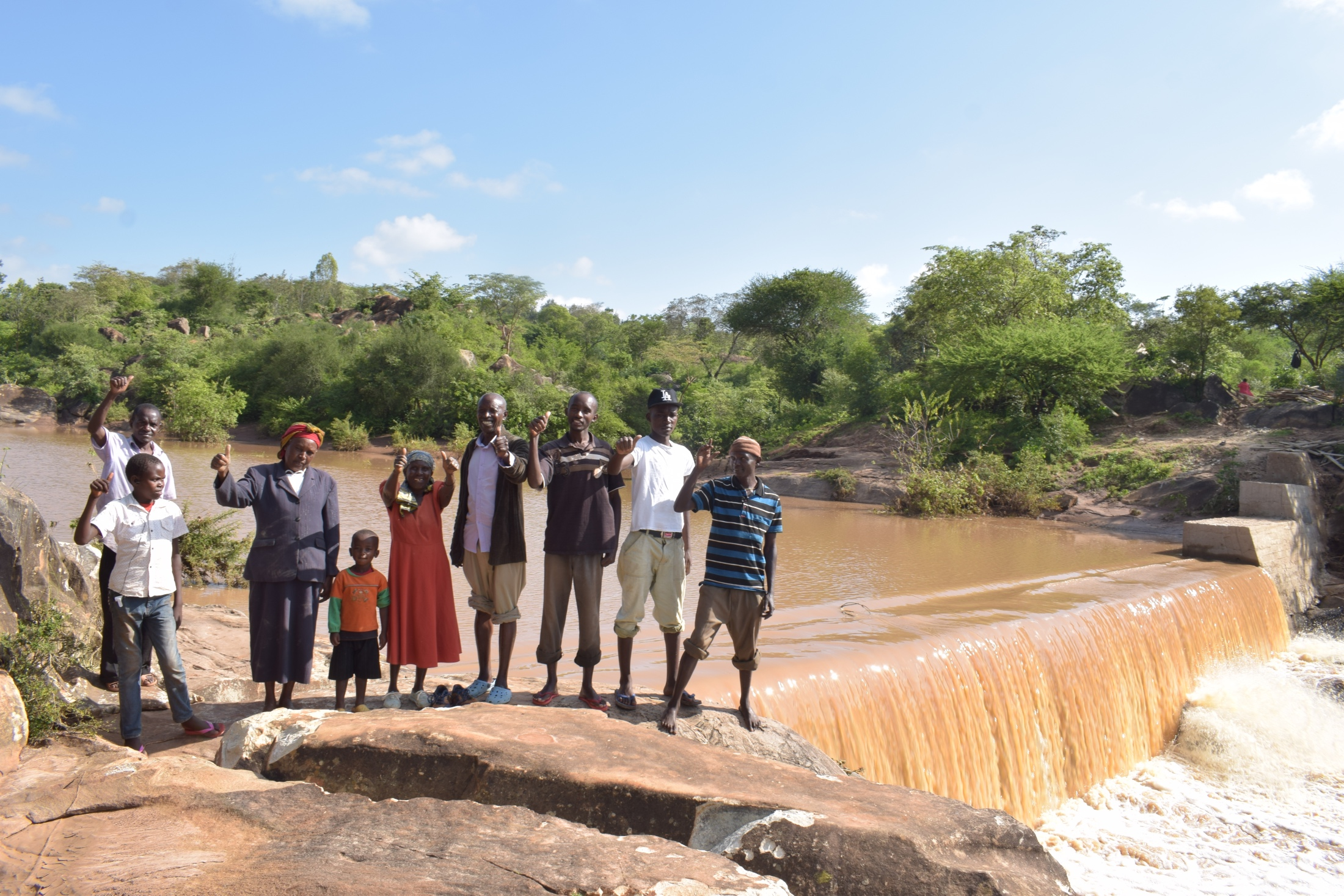 The Water Project : kenya18186-thumbs-up-for-a-new-sand-dam