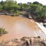 The Water Project: Kithuluni Community B -  Water From Recent Rains Gathers Behind The Dam