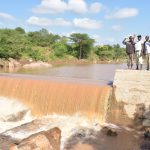The Water Project: Kithuluni Community B -  Waving From The Top Of The Dam