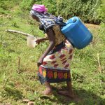 The Water Project: Ivumbu Community -  Carrying Water Home