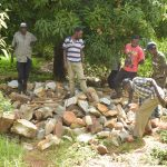 The Water Project: Ivumbu Community -  Commuity Members Gathering Materials To Prepare For Dam Construction