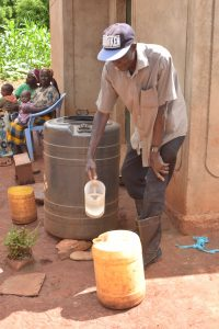The Water Project:  Fetching Water From Large Storage Container
