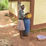 The Water Project: Ivumbu Community A -  Filling Water Storage Container