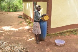 The Water Project:  Filling Water Storage Container