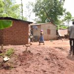 The Water Project: Ivumbu Community A -  People Walking About In Household Compound