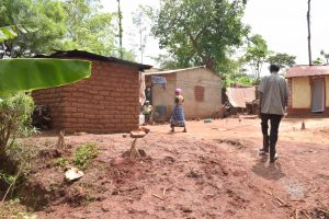 The Water Project:  People Walking About In Household Compound
