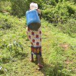The Water Project: Ivumbu Community A -  Treking Up The Hill With A Container Filled With Water