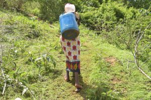 The Water Project:  Treking Up The Hill With A Container Filled With Water