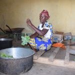 The Water Project: Kakunike Primary School -  School Cook Prepares Kale For Students