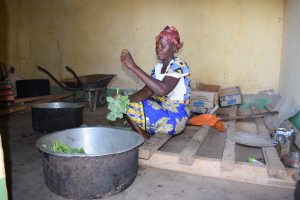 The Water Project:  School Cook Prepares Kale For Students