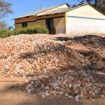 The Water Project: Kakunike Primary School -  Stone Collected For Tank Construction