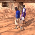The Water Project: Kwa Kyelu Primary School -  Carrying Water Back To School