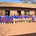 The Water Project: Kwa Kyelu Primary School -  Students Lined Up With The Water Containers They Bring Each Day