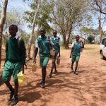 The Water Project: Kyandoa Primary School -  Boys Carrying Water To School