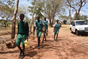 The Water Project:  Boys Carrying Water To School