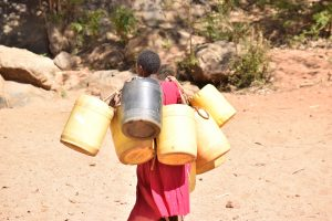 The Water Project:  Carrying Water Containers To The Scoop Hole