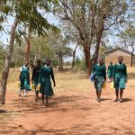 The Water Project: Kyandoa Primary School -  Students Arrive At School With Their Water