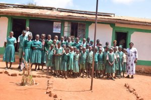 The Water Project:  Students Pose In Front Of The School