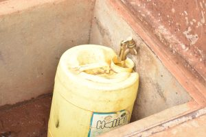 The Water Project:  Collecting Water From Storage Tank
