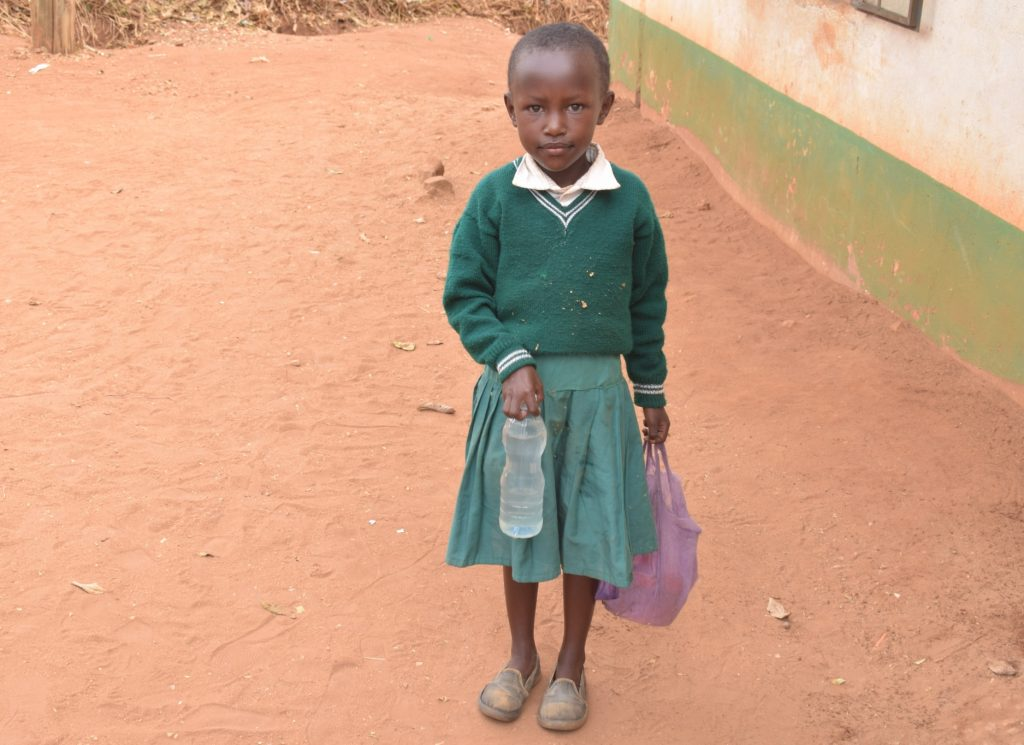 The Water Project : kenya19252-girl-holds-water-bottle