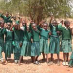 The Water Project: AIC Mbao Primary School -  Girls Waving