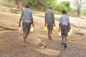 The Water Project:  Boys Walking Back To School With Water